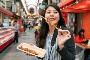 women eating street food in japan